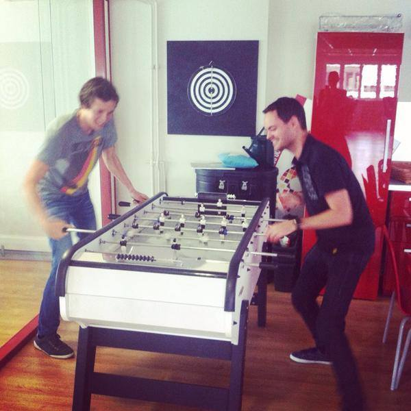 Cofounders Pierre and Mathieu playing foosball