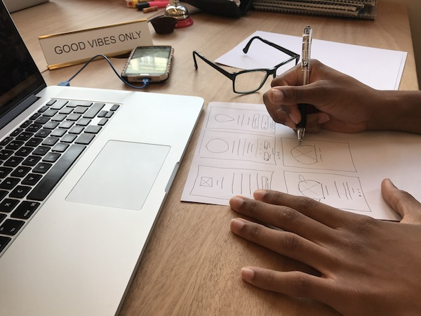 This photo has a tight crop and is much more effective at telling the story of what he's working on – wireframes for an app! He also had no idea this photo was being taken. (FYI, there are a few versions of this shot that were taken with slightly differ