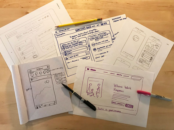 Different styles of wireframes using templates, graph paper and plain sheets of paper.