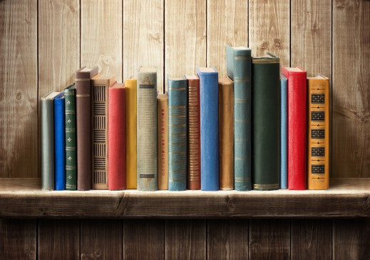 Books of different sizes, colors, and lengths