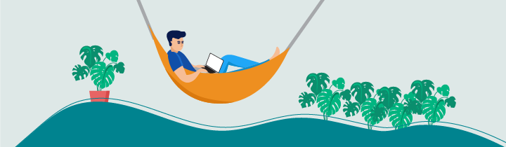 Man sitting in a hammock and working on a laptop
