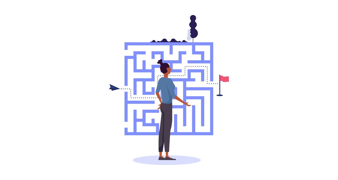 Marketer devant un labyrinthe, traçant le chemin à suivre.