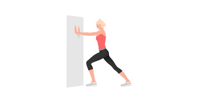 Appuyez sur un mur vos deux mains écartées et à hauteur de la tête, une jambe vers l'arrière tendue, et l'autre plus près du mur avec le genou un peu fléchi.